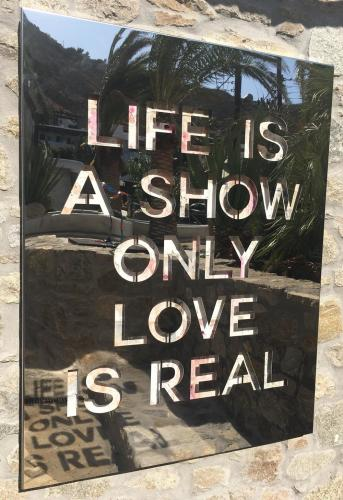 Life Is A Show Only Love Is Real